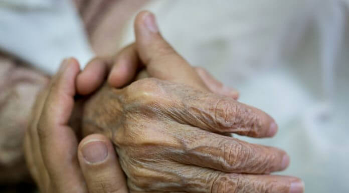 holding hand of an elderly relative