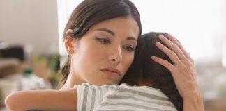 sad mother comforts child - photo by Jose Luis Pelaez Inc/DigitalVision/Getty Images