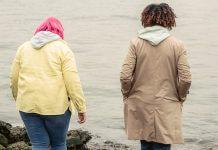 women in jackets walking outside together - photo by John Diez from Pexels