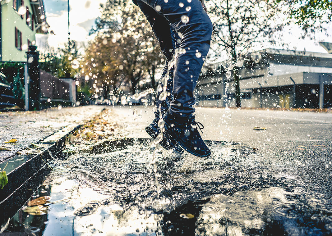 leaping into puddle - photo by Raphael Schaller on Unsplash