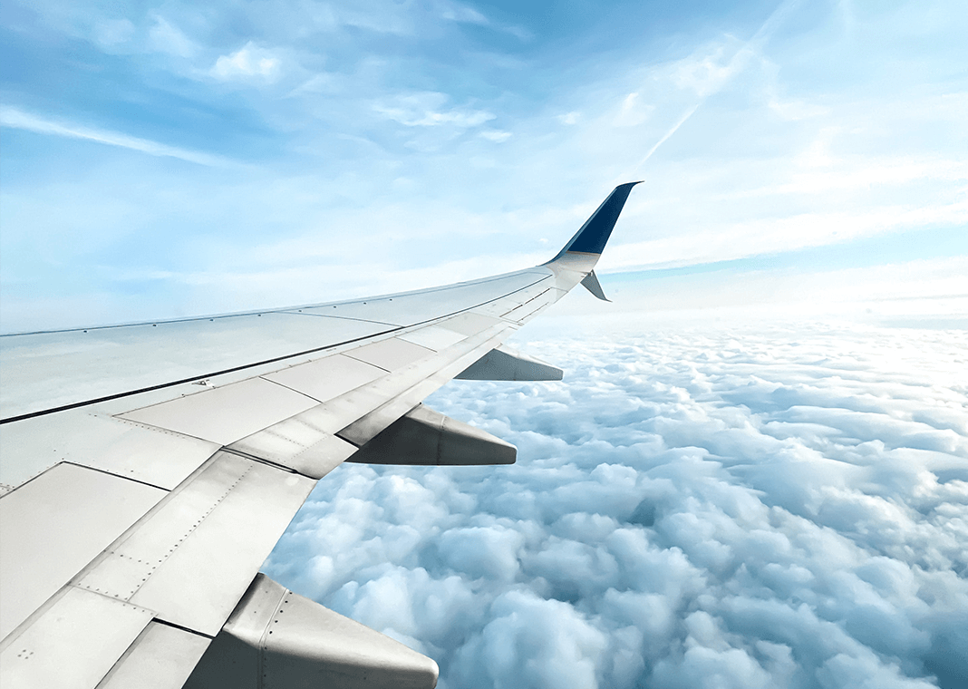 airplane in clouds - photo by Natali Quijano on Unsplash