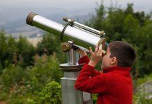 boy looking through telescope - Borislav Toskov/Shutterstock.com